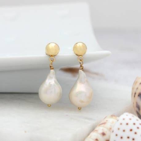 modern white meteor pearl earrings on silver or gold studs, statement wedding earrings