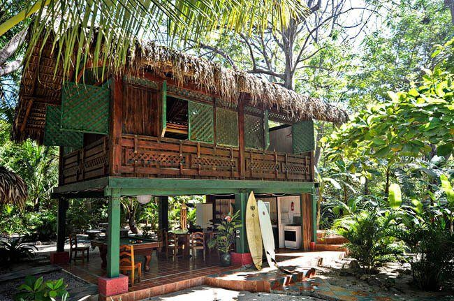 Central America: Costa Rica. On much of the Caribbean coast, you will find mostly wooden houses, built on raised stilts to rise above the wet ground and occasional flooding. Some of these houses feature ornate gingerbread trim.