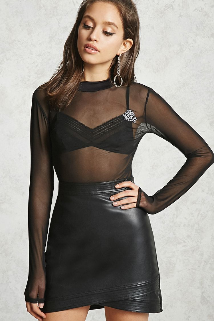 A sheer mesh knit top featuring a mock neck long sleeves and a
