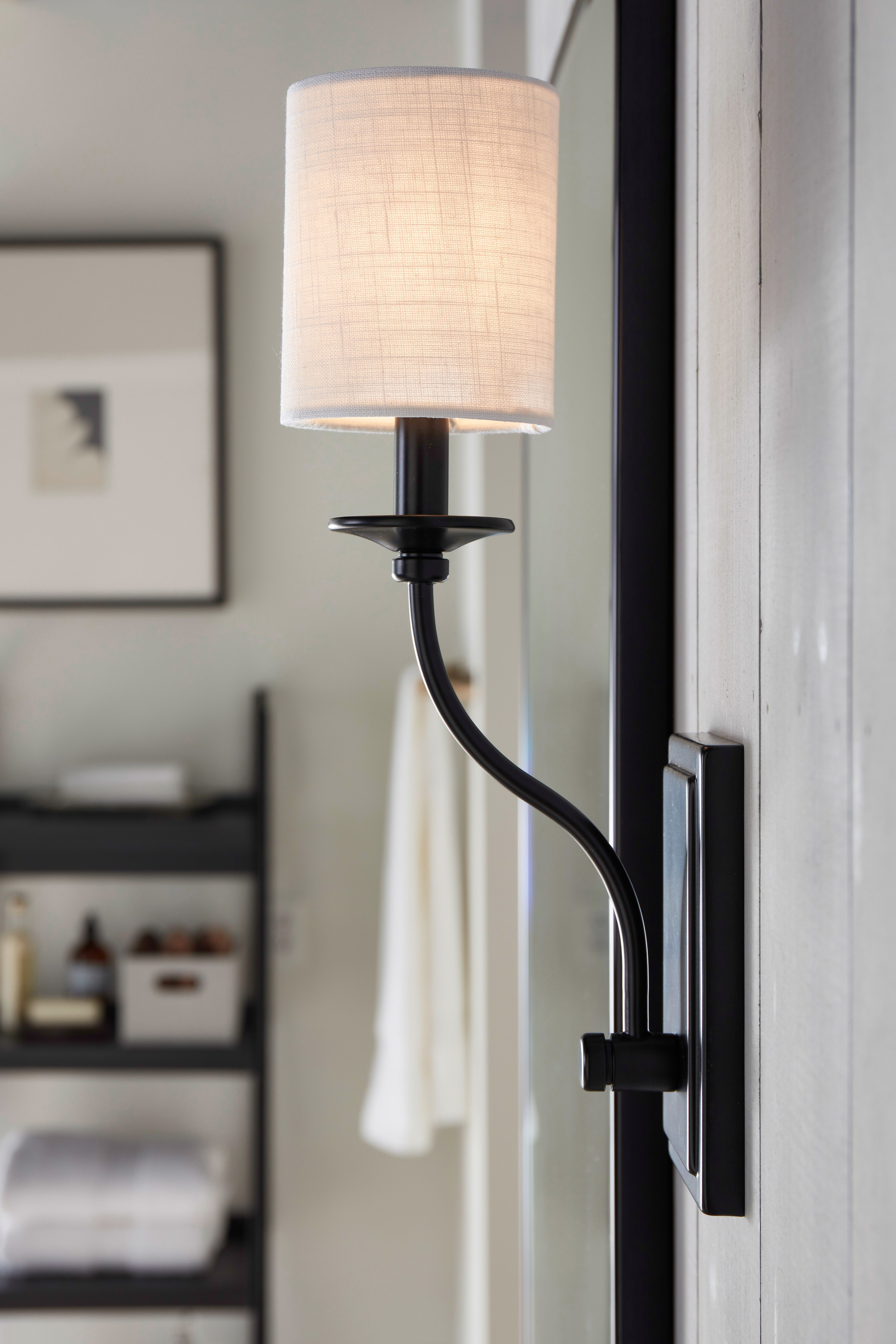 Wall Sconce In An Antique Bronze