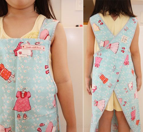 Free Pattern, Tutorial and Sewing Video - Cross back apron for adult and kids. only the kids version is shown, but this has a nice neat finish to it. like the idea of bias binding at the seams so that it's reversible and neat, although that would be a ton of binding to either hunt down or make!