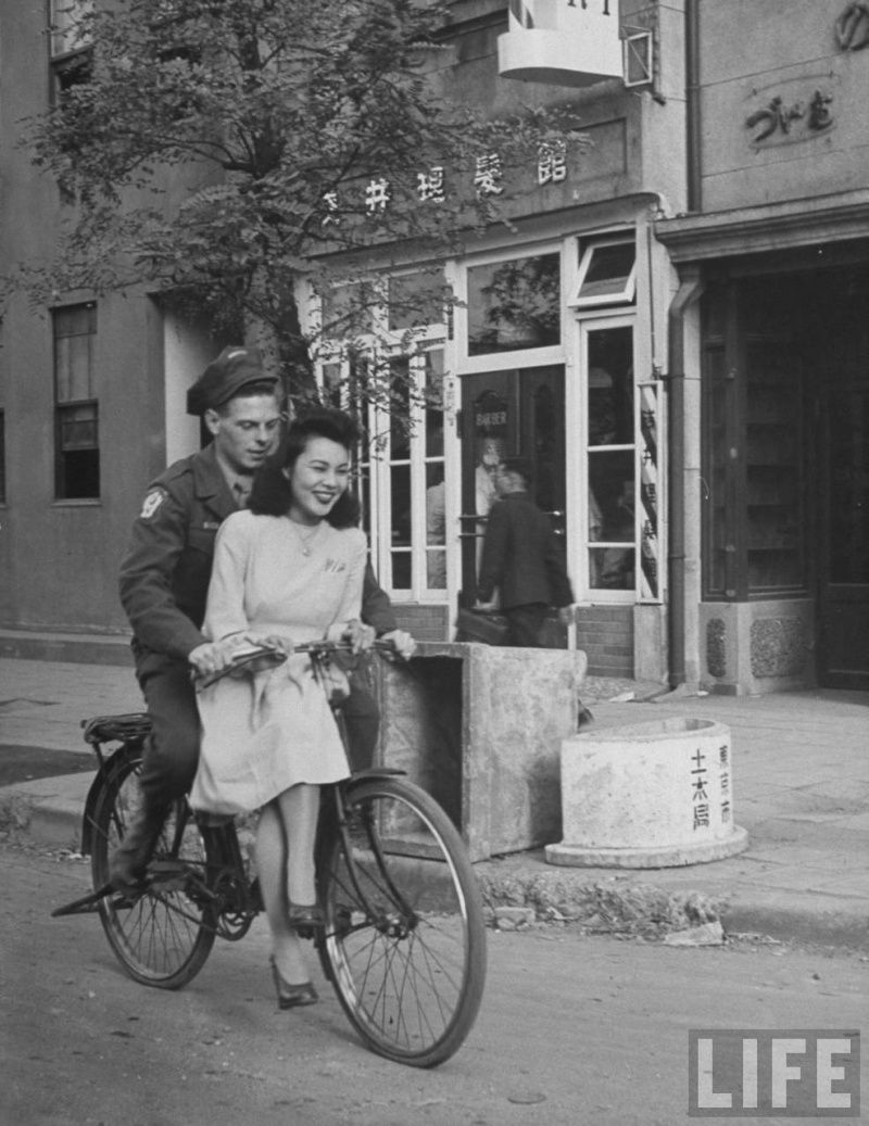 Us Soldier Giving Japanese Girl A Bicycle Ride With Handlebar