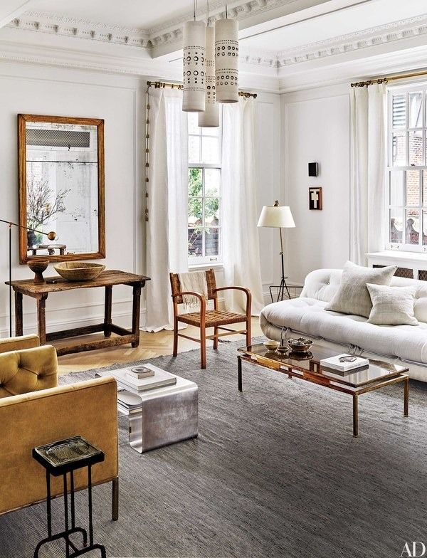 The former manhattan living room of designers nate berkus and jeremiah brent features circa 1970 georges pelletier ceramic lights above a vintage sofa by