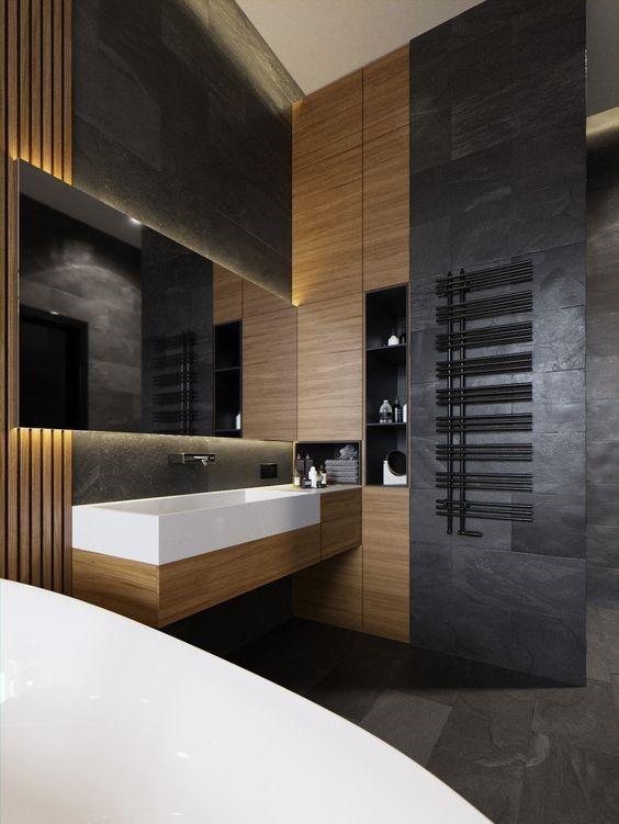Wc wie hotel mit holz und dunklen fliesen dekoriert for Hotel badezimmer grundriss