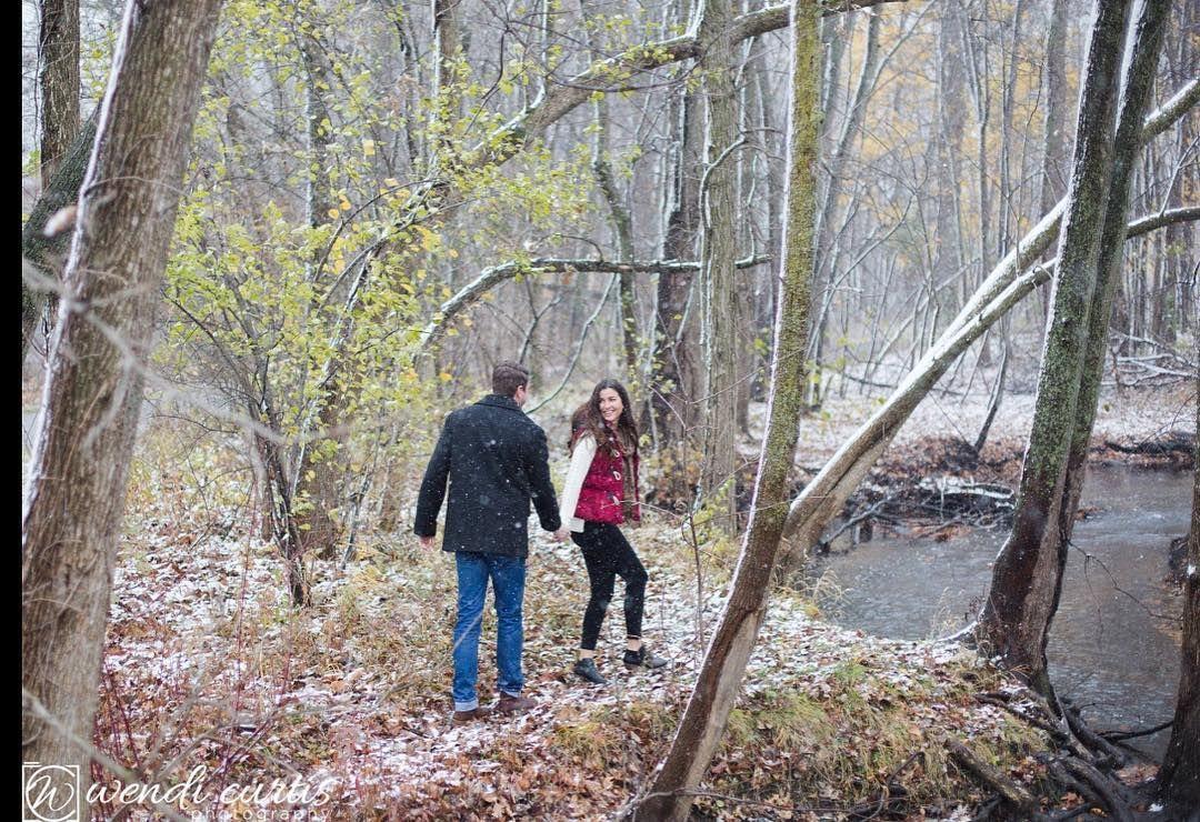 Walking in a winter wonderland. #michigan #pinetrees #talltrees #snow #winterishere #river #frozen #engagementphotos #grandrapids