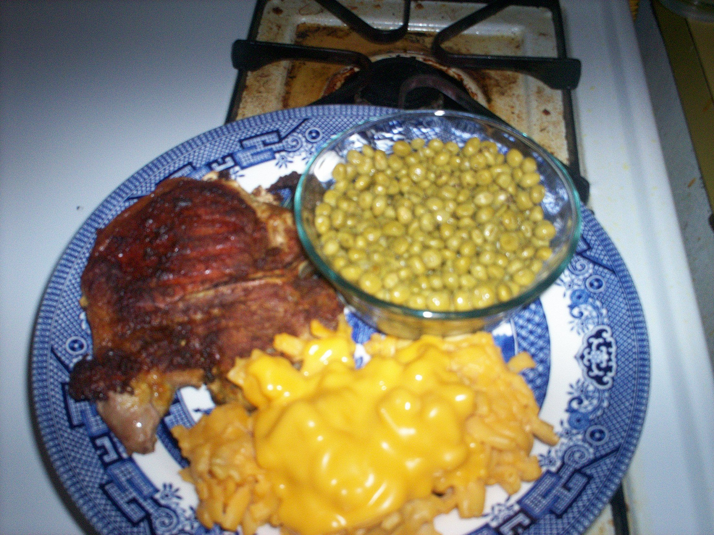pork chop.peas with butter.mac and cheese.