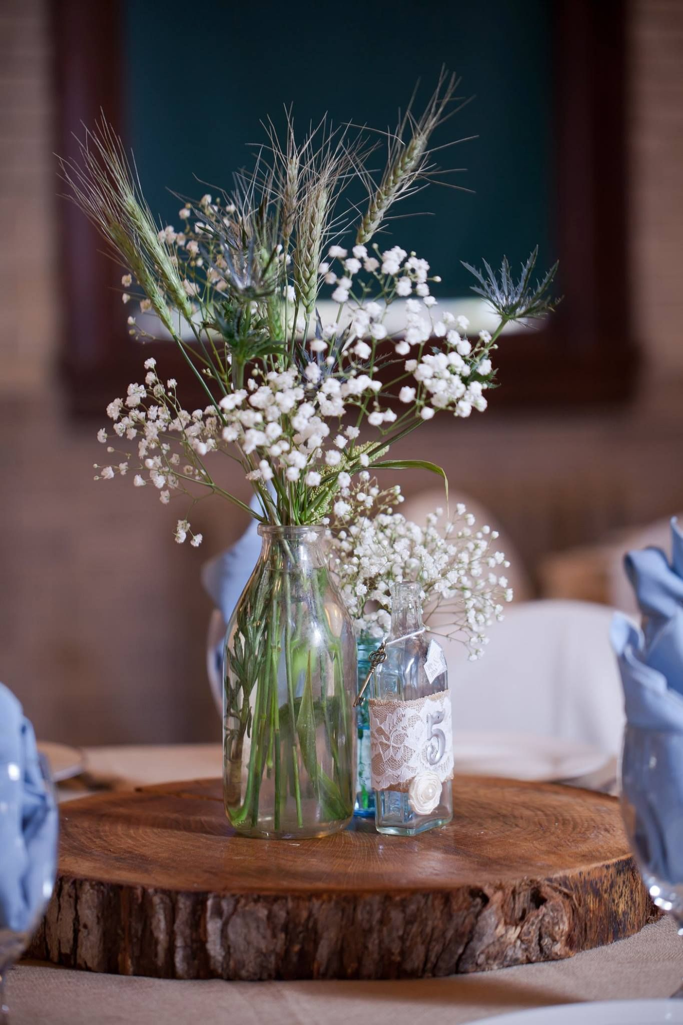 Rustic wedding centerpiece wood slab vintage bottle