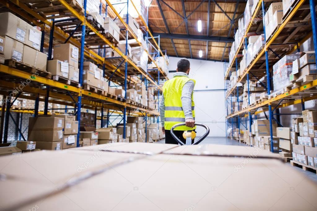 Male Warehouse Worker Pulling A Pallet Truck Stock Photo Affiliate Worker Pulling Male Ware In 2020 Pallet Rack Warehouse Worker Warehouse Pallet Racking
