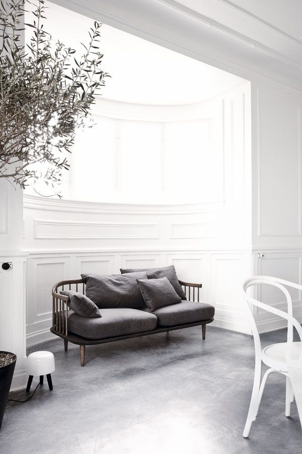 Beautiful treatment idea for an Ercol Sofa! Subdued and sexy... really plays up the dark wood
