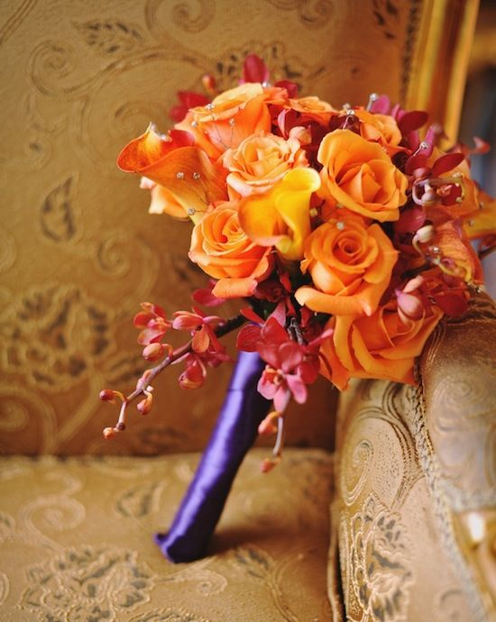 Orange and red bridal bouquet with purple stem wrap. From: Brenda's Wedding Blog. Photos: Kismis Ink Photography