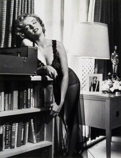 Philippe Halsman - Marilyn listening to music