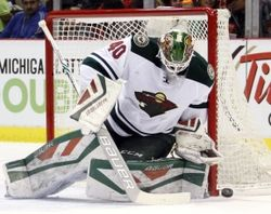 Minnesota Wild goalie Devan Dubnyk (40) makes a save during the second period against the Detroit Red Wings at Joe Louis Arena.  #9223247