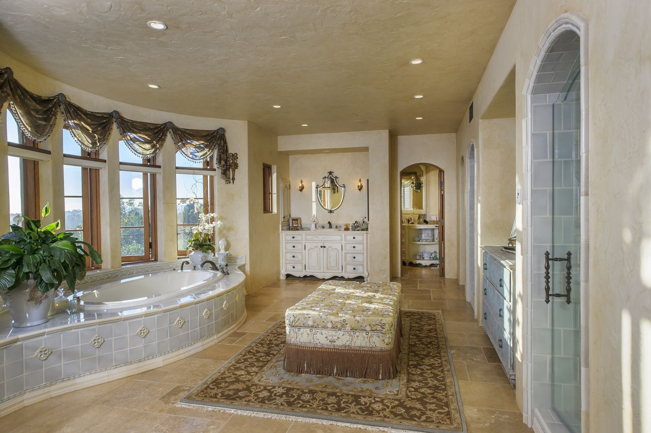 Master bedroom with jacuzzi tub  Jacuzzi tub floating island waterfall shower A bath room fit for