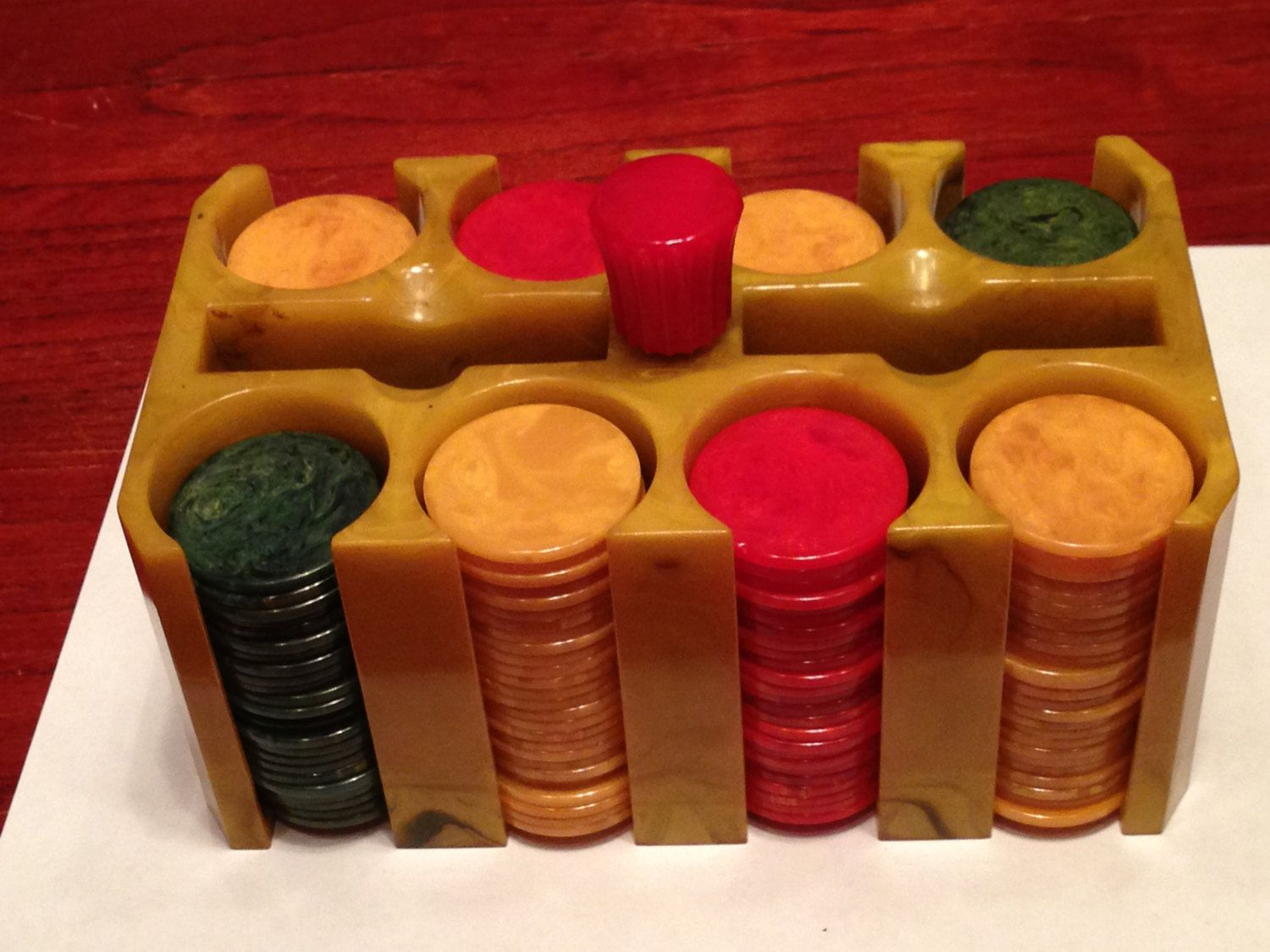 Beautiful Set of 200 Catalin Bakelite Poker Chips in a Butterscotch and Chocolate Swirl Bakelite Poker Chip Caddy by MainlyManlyAntiques on Etsy https://www.etsy.com/listing/155968372/beautiful-set-of-200-catalin-bakelite