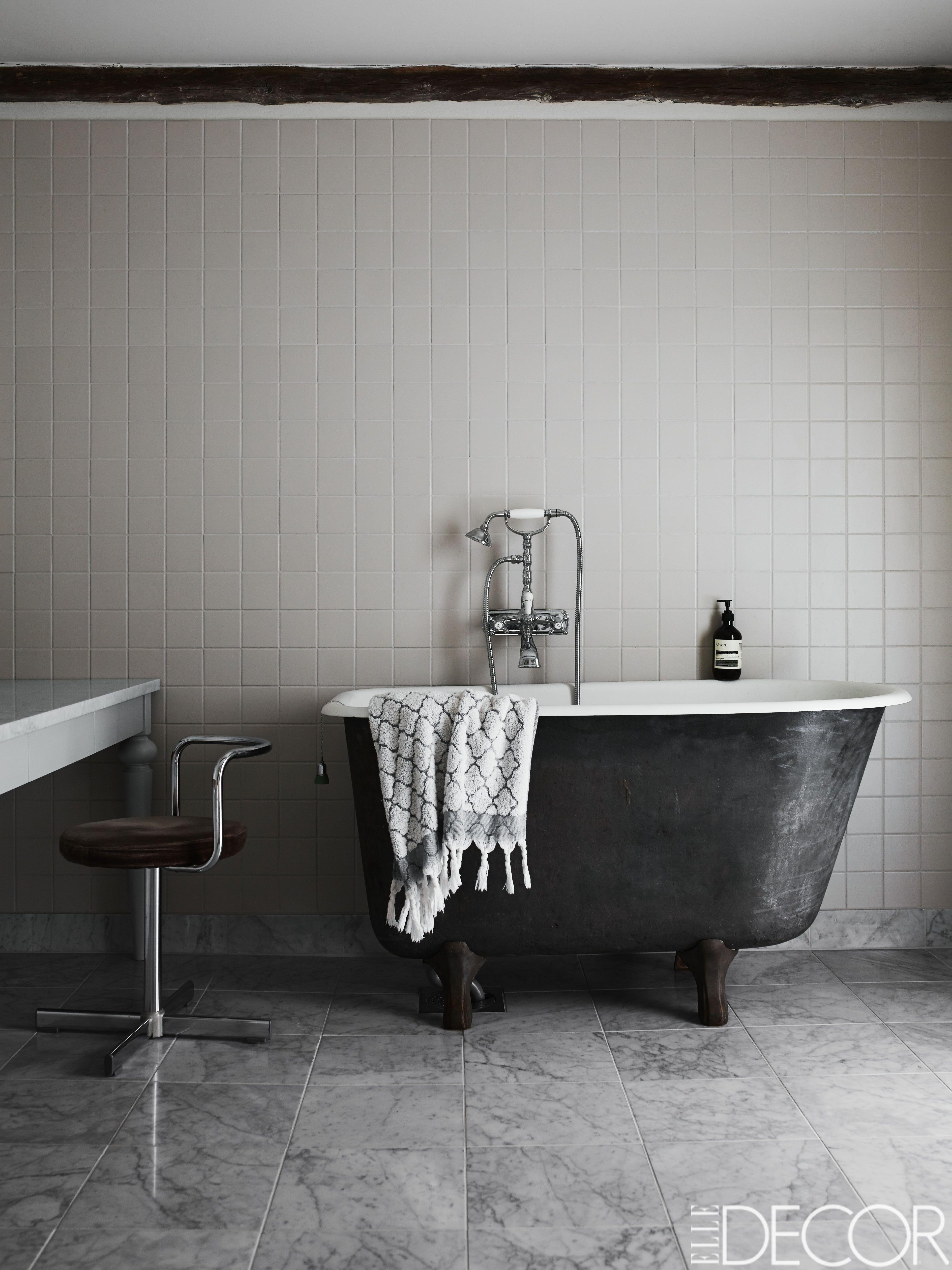 traditional black bathroom. A Vintage Tub With Fittings By Mora Armatur In Bathroom; The Floor Is Tiled Carrara Marble. - ELLEDecor.com Traditional Black Bathroom I