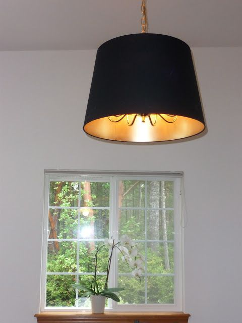 Ikea Jara Lamp Shade Hacked With Gold Spray Paint Then Hung Over Existing Chandelier For A Sophisticated Lighting Solution