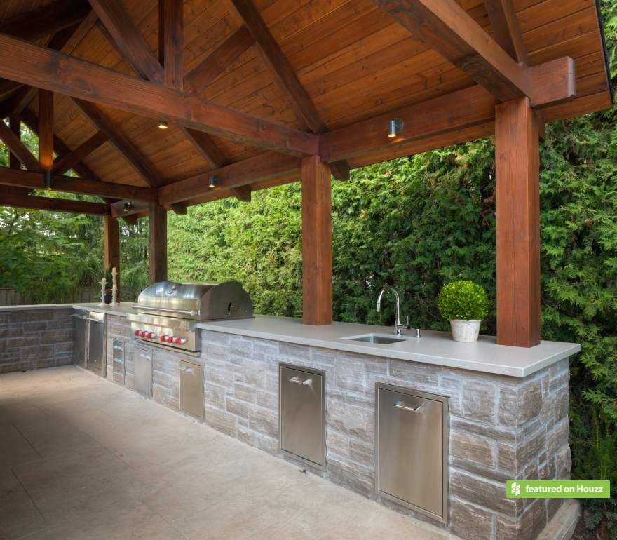 This Outdoor Kitchen Is Clad In Wiarton Ledgerock And Features A Wet Bar And Gourmet Wolf Grill With A Full Complement Of Luxury Stainless Steel Accessories Li