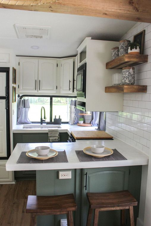 This remodeled RV has the coziest fireplace you've ever seen in a tiny home (and it's for sale!). C