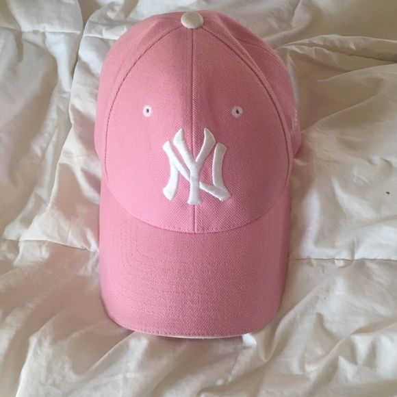 Light pink and white Yankee hat Light pink with NY symbol in white.  Adjustable Velcro in the back to fit any head size. Barely worn. a9b950592ed8