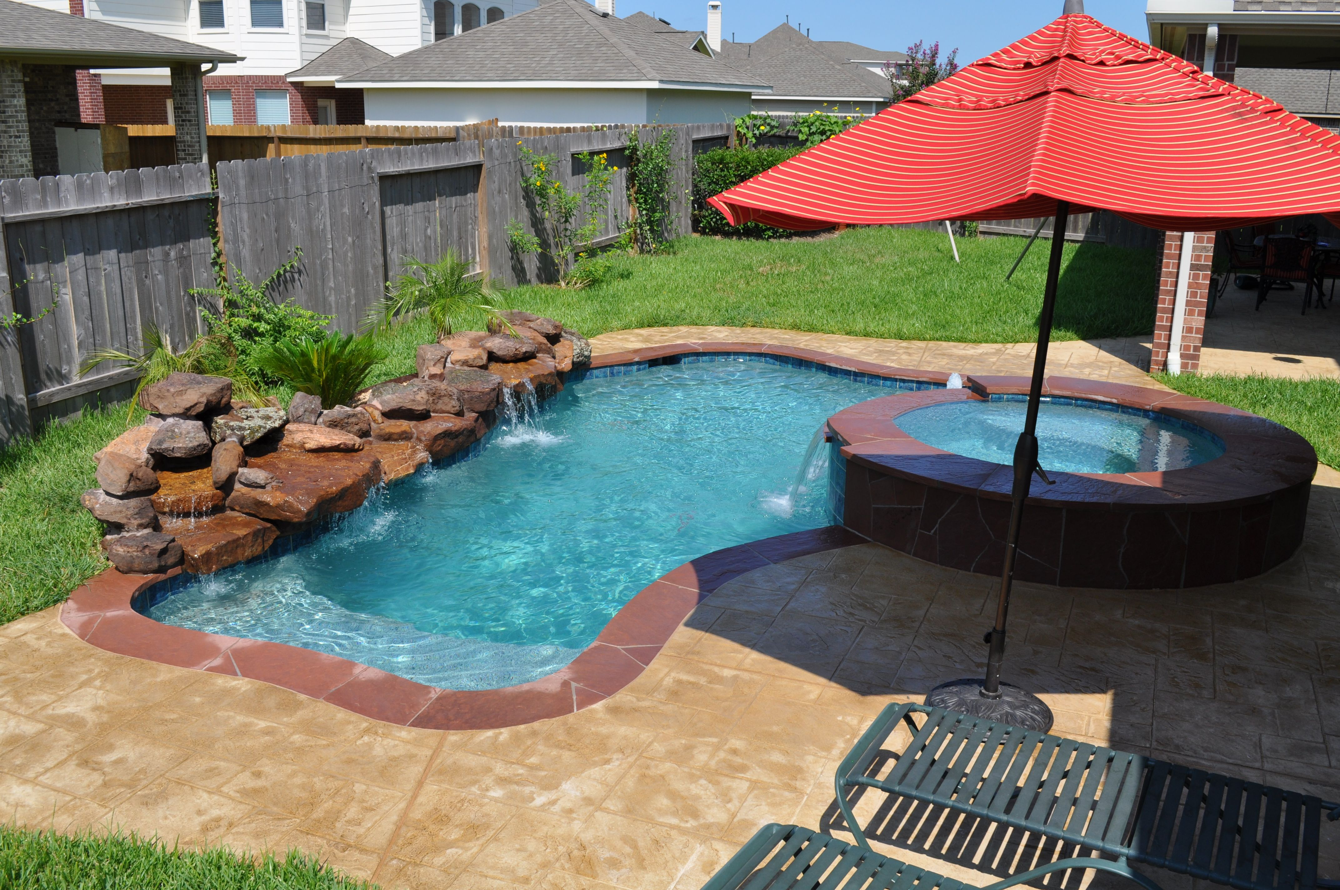 This Small Pool And Spa In Katy Tx Houston Features Stamped Overlay Concrete Deck An Ashlar Stone Pattern Waterfall Overflowing 18 Deep