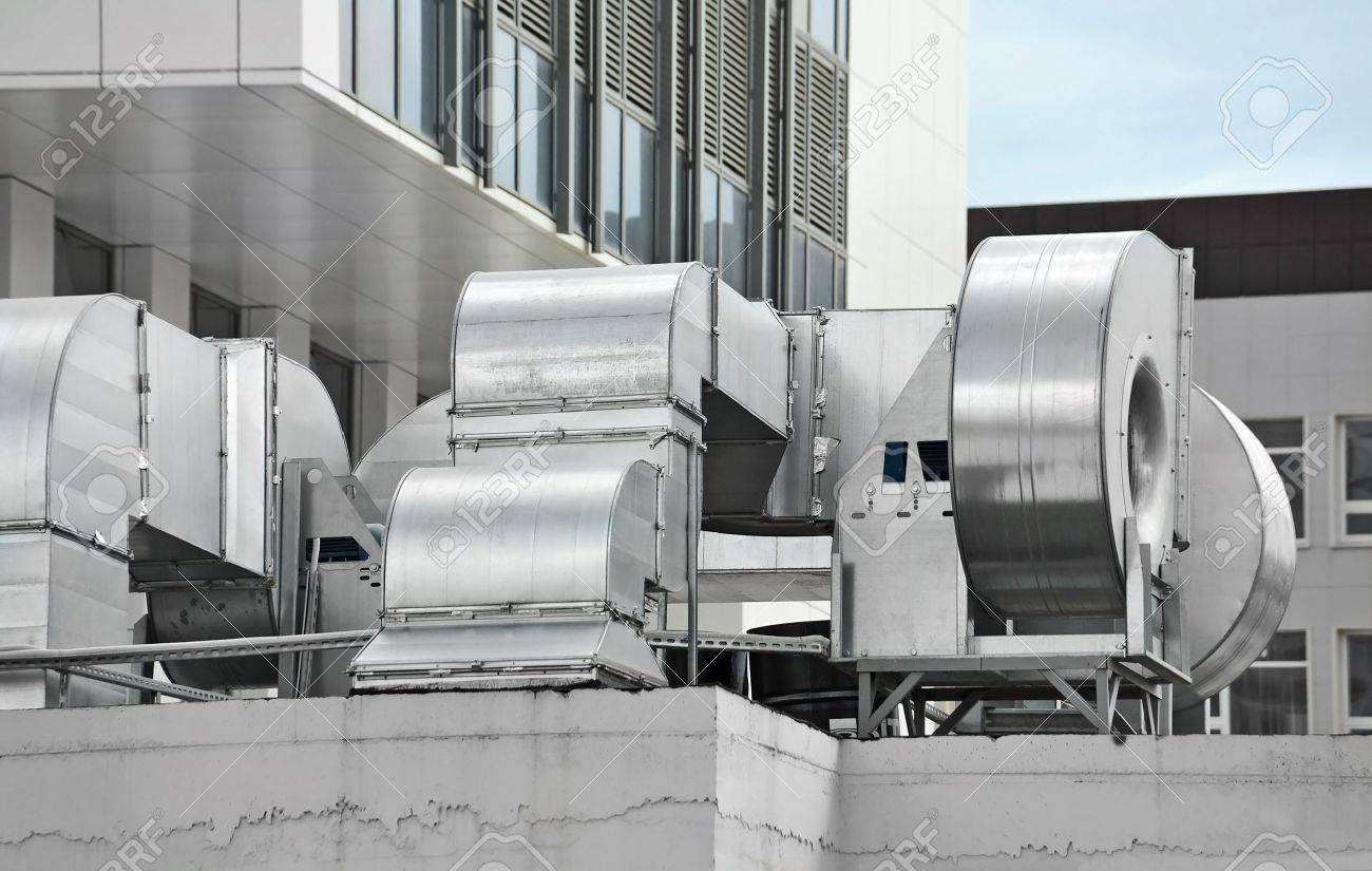Industrial Air Conditioning And Ventilation Systems On A Roof Industrial Air Conditioning Heating And Air Conditioning Ventilation System