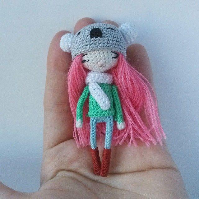 Tiny amigurumi doll wearing a koala bear hat. (Inspiration).