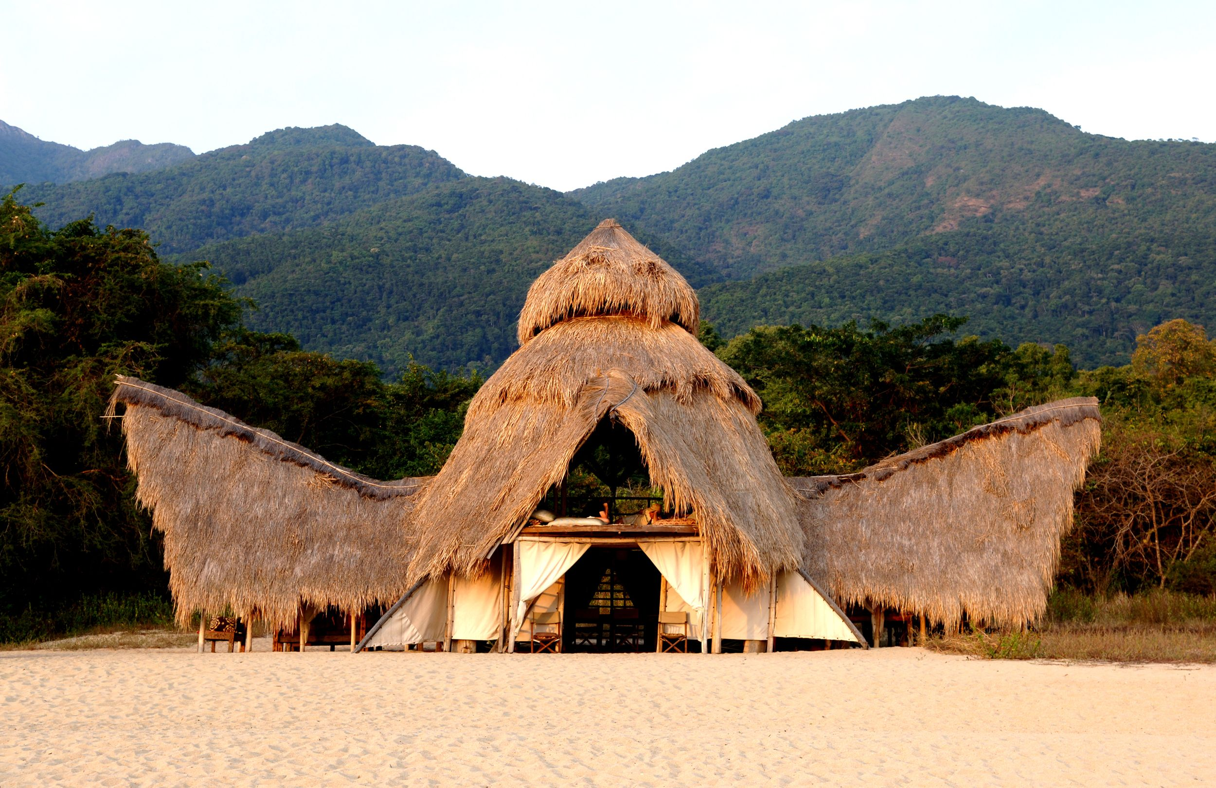 Greystoke Mahale has just six tents set under thatched roofs and shaded by palm groves that overlook the waters of Lake Tanganyika.
