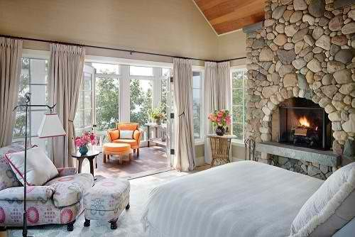 bedroom with sun room and fireplace, wow