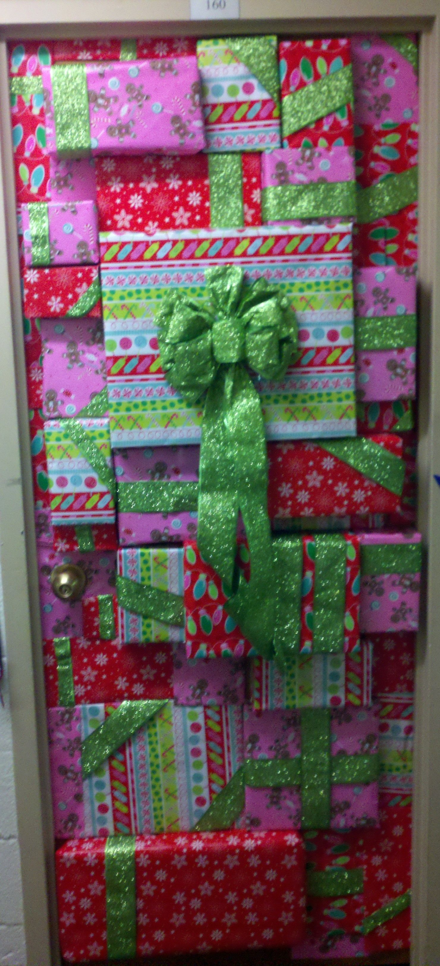 lets wrap our door for Christmas..one solid wrap though not like a ton  Dorm  Door DecorationsChristmas ...