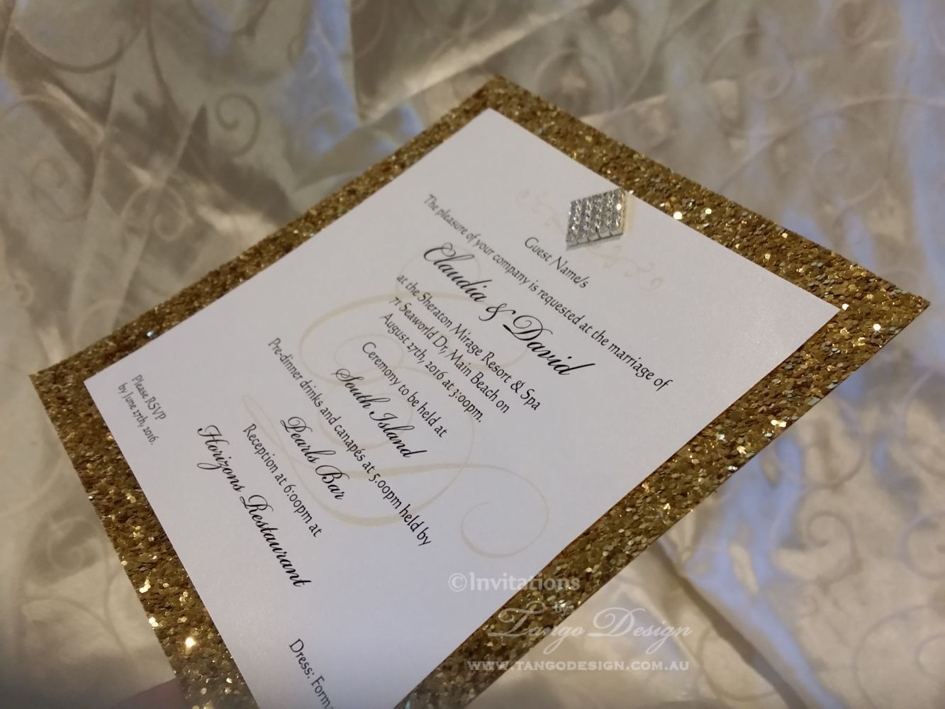Glitter wedding invitation in gold foil metallic