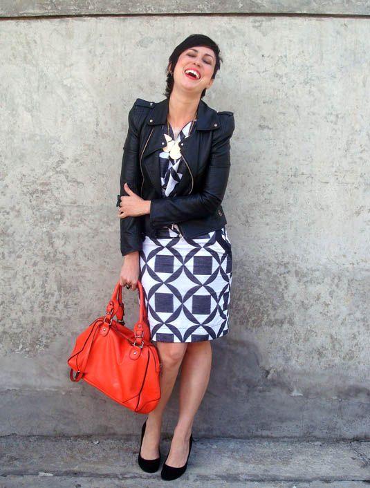orange purse bag, black and white ronaldo fraga dress, black leather jacket