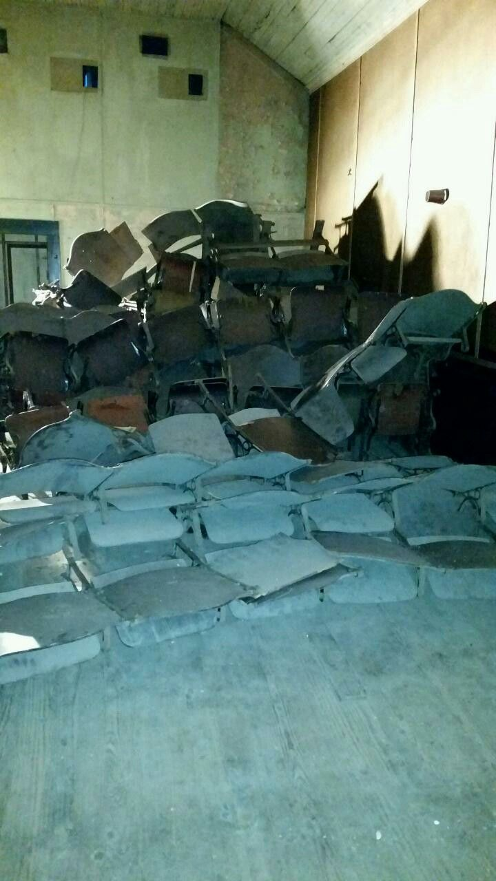 A pile of the original wood and iron seats in The Strand Theater.