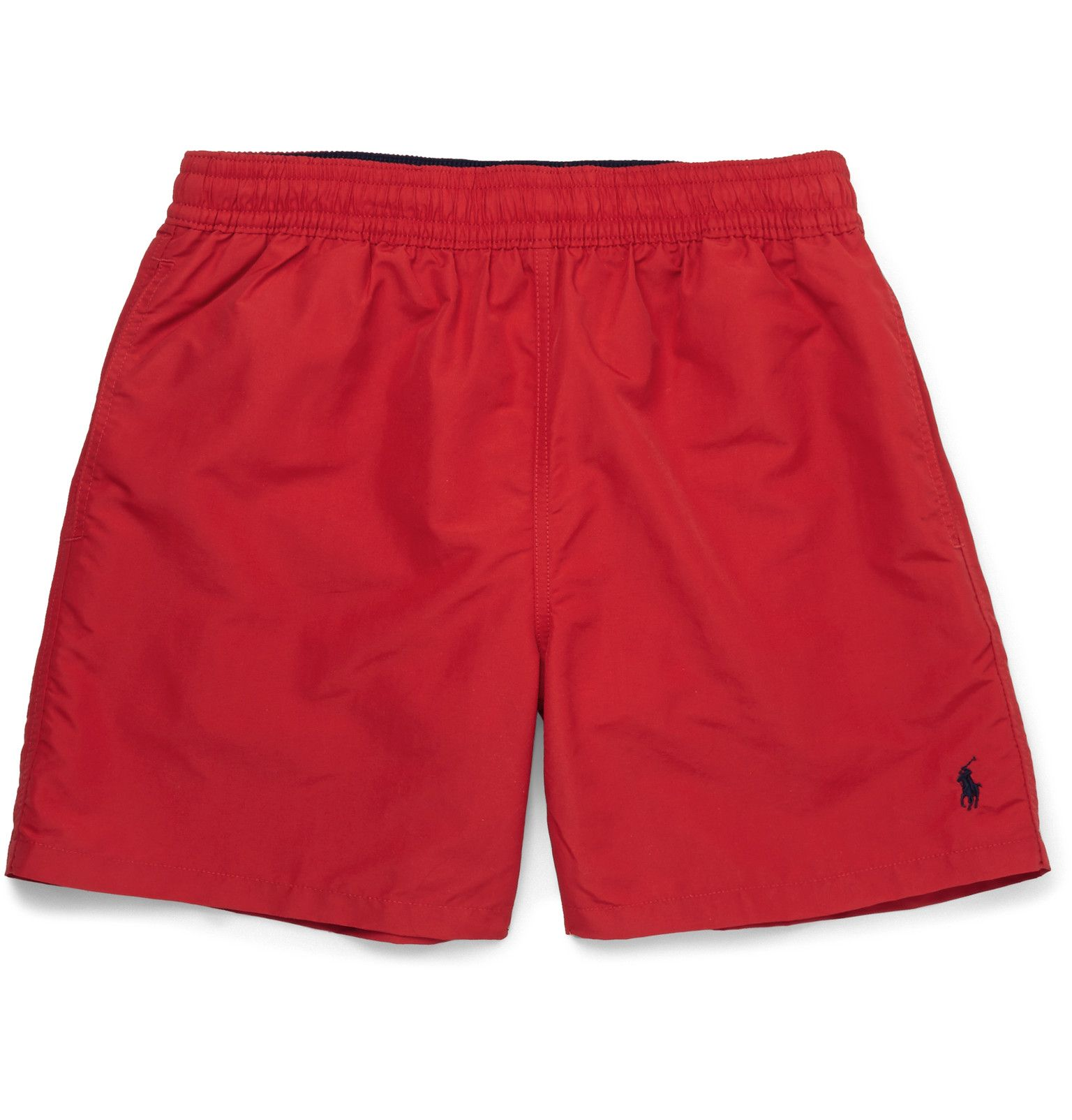 Make a dashing impression on beach-bound days in these bold red swim shorts  by