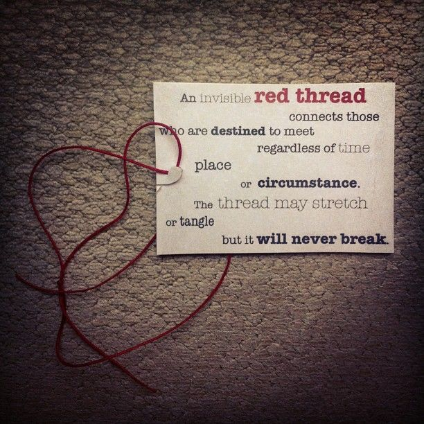 Red threads connecting thumbs