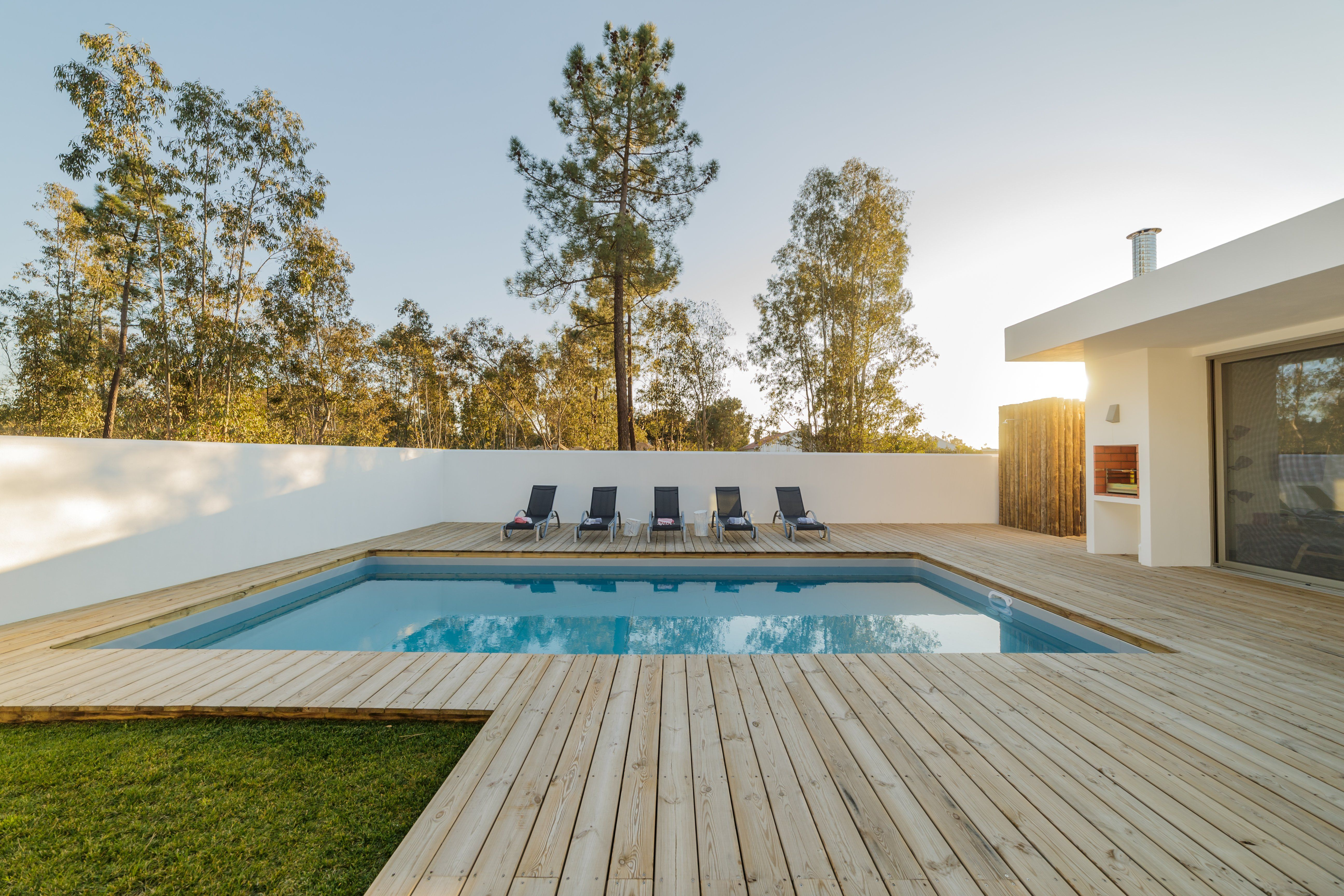 Wooden Decks For Inground Swimming Pools Cost Types And More Decks Around Pools Wood Pool Deck Wooden Pool Deck