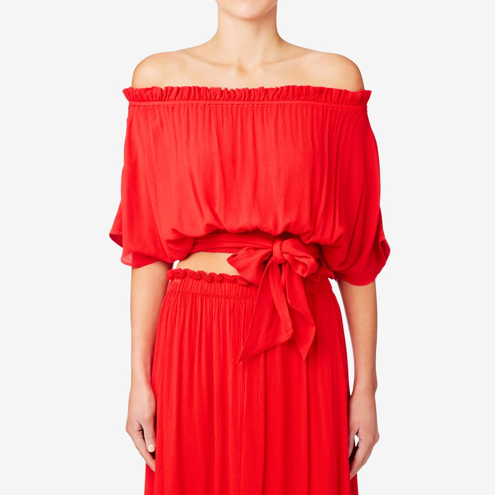 This top features an off the shoulder neckline and a vibrant shade