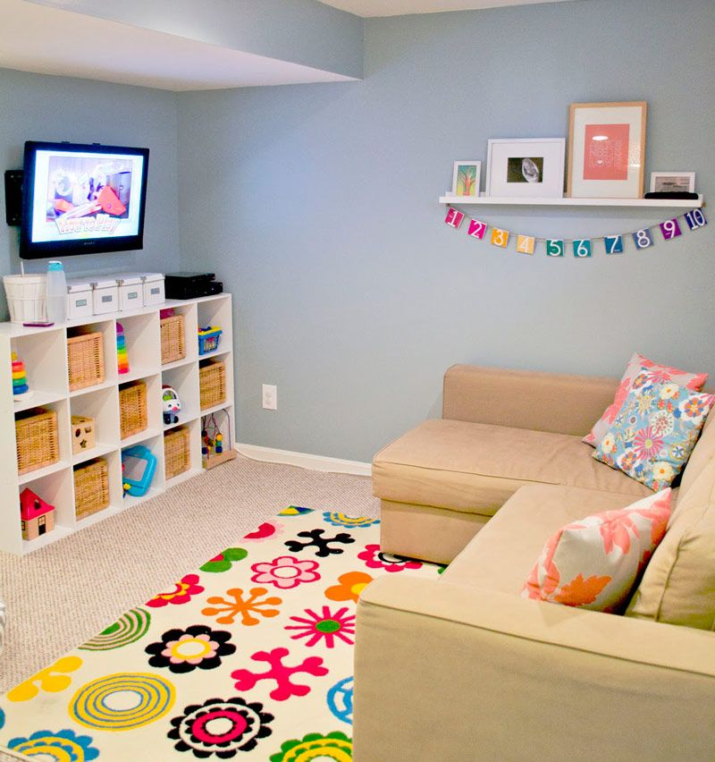 playroom with bright rug would love a bigger playroom in our future house to fit a couch and tv