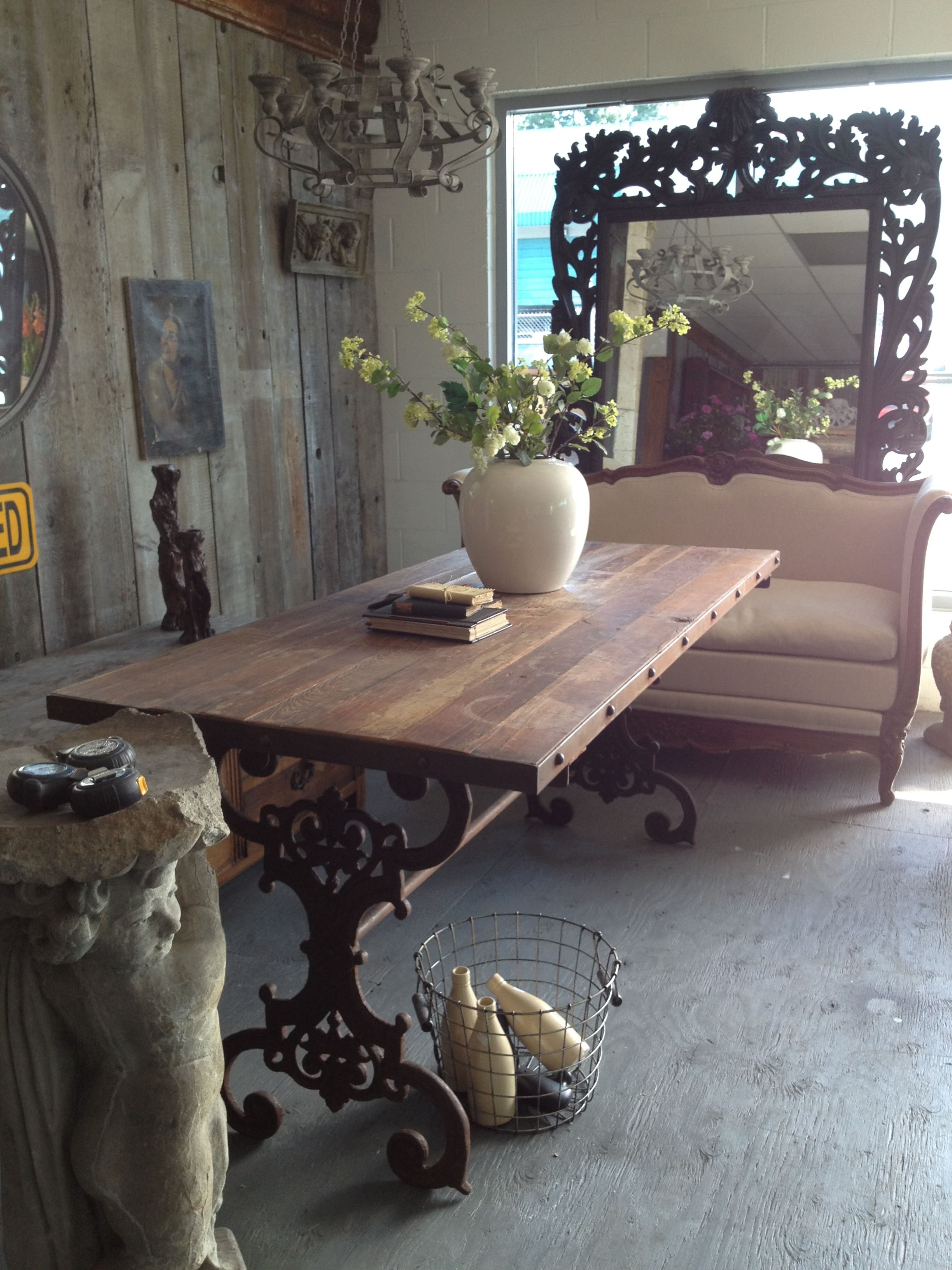 rustic table top with wrought iron base