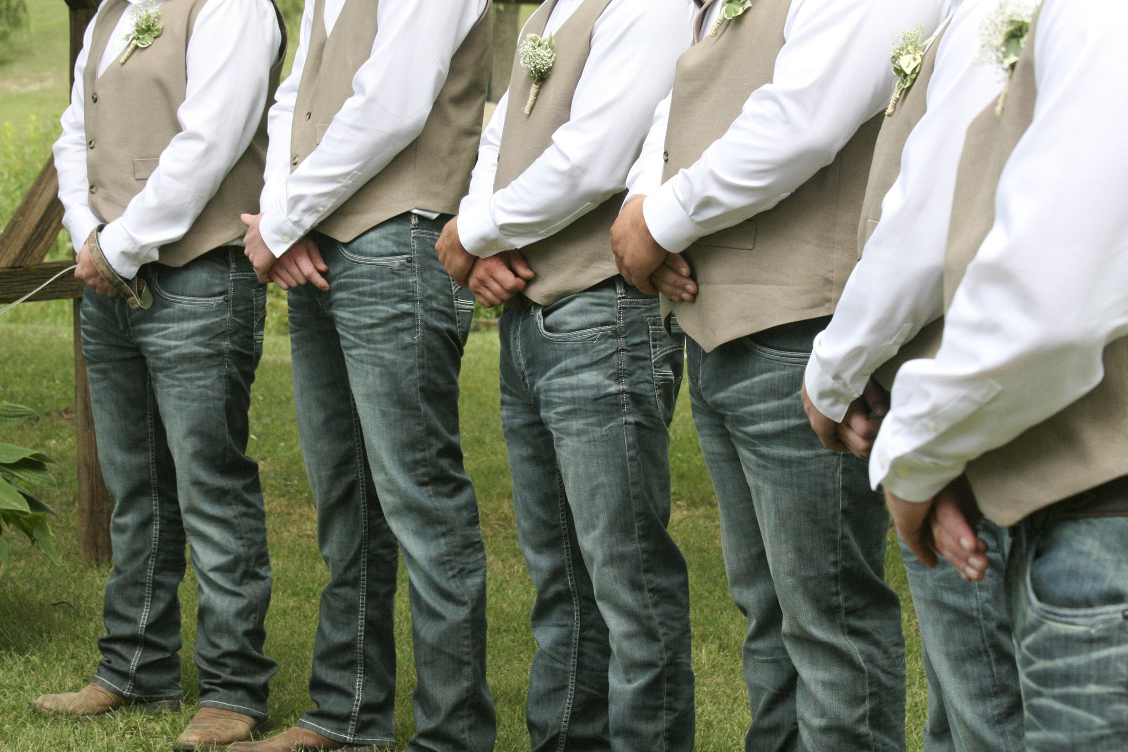 Groomsmen wore jeans, cowboy boots, vests and white dress