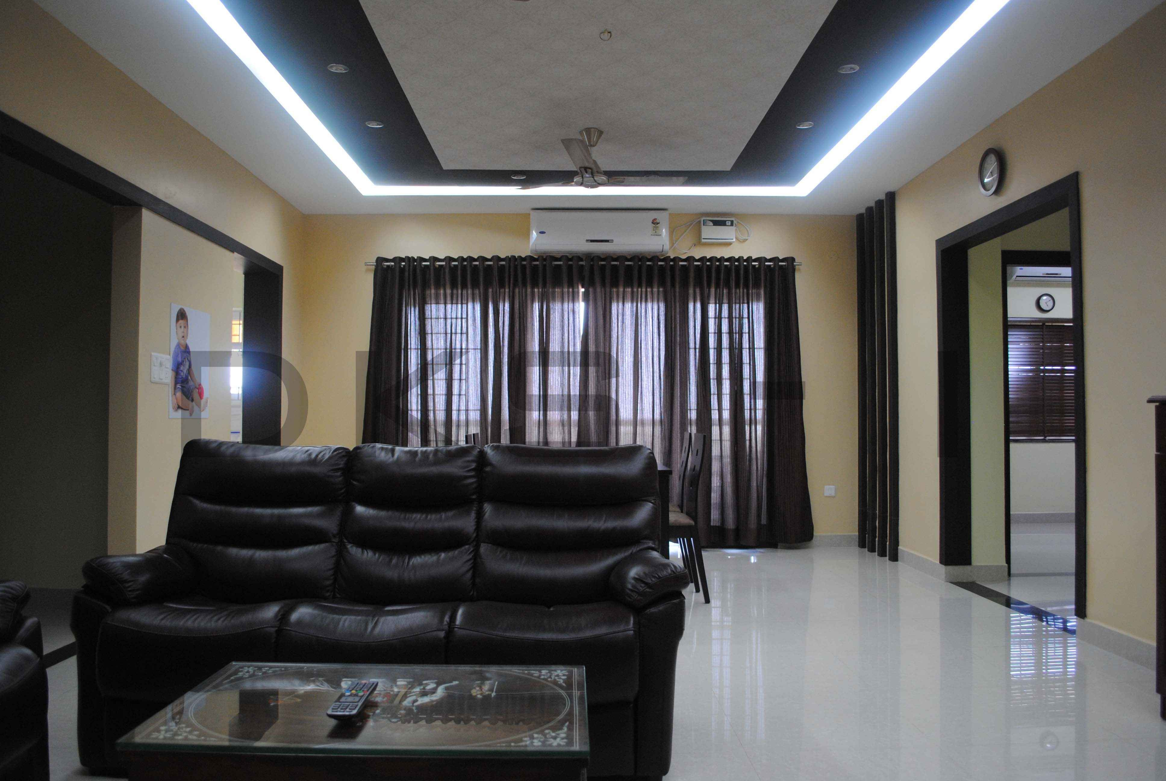 Living Room With Black Sofas Curtains Design By Karthikeyan
