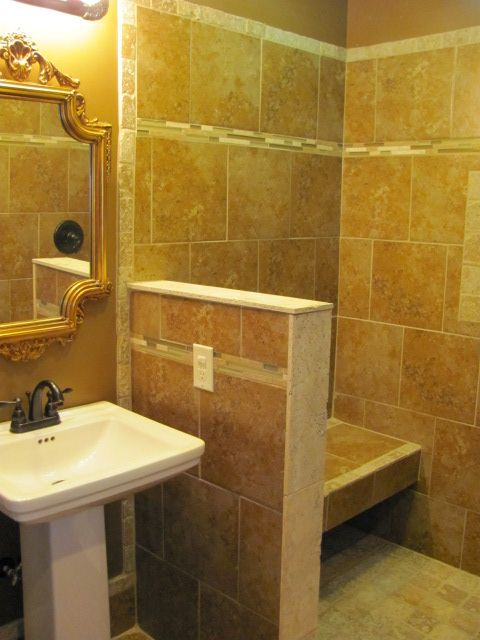 Bathroom Knee Wall small knee wall, wrapped in tile and stone, gives support to a