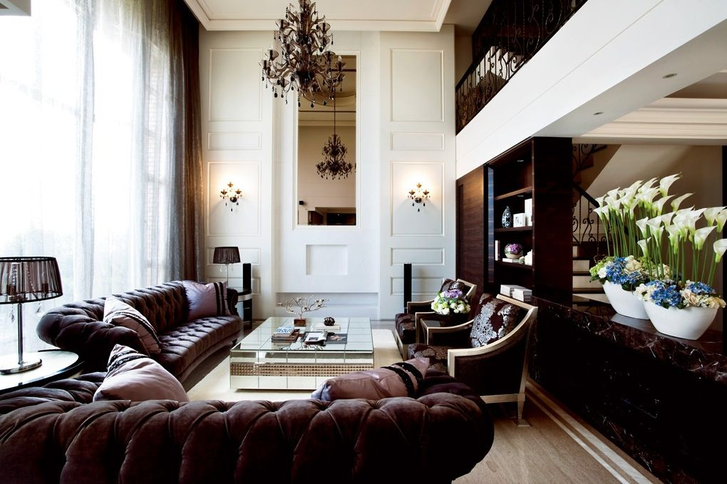Interior Traditional Living Room With High Chandelier