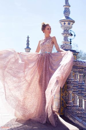 Oksana Mukha is a world-renowned European designer of couture ...