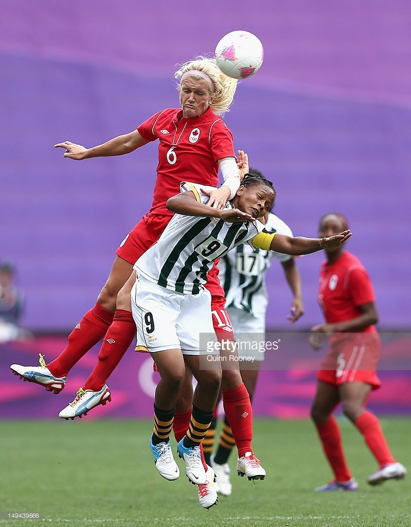Kaylyn Kyle of Canada heads the ball over the top of Amanda Dlamini of South Africa during the Women's Football first round Group F Match of the London 2012 Olympic Games between Canada and South Africa, at City of Coventry Stadium on July 28, 2012 in Coventry, England.