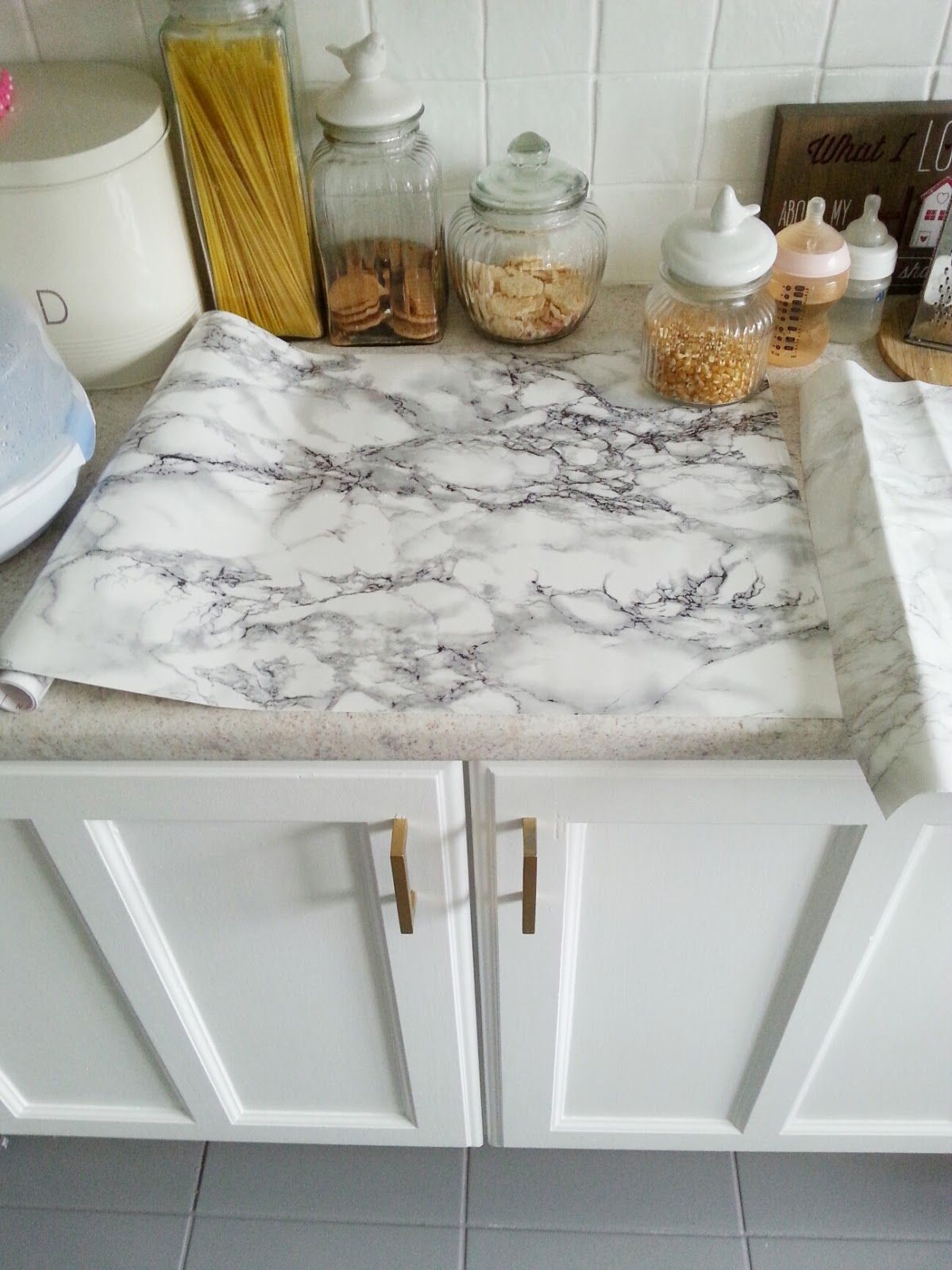 diy super cheap, easy marble look counters done with contact paper.  www.makedoanddiy