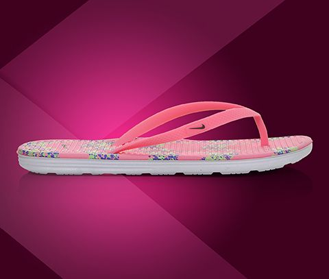8d896f3a8830 Women s Nike Solarsoft Print Flip Flops in Digital Pink at Shoe Carnival.