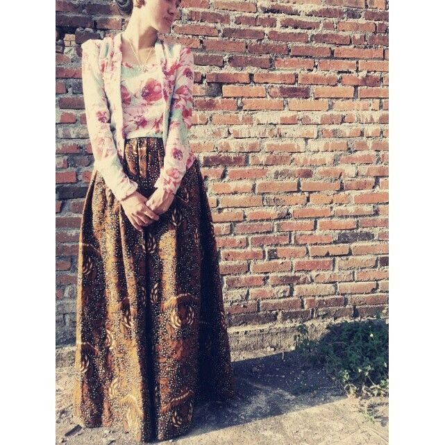 Photo of Kebaya kutu baru and the batik skirt my sister made for her graduation day..
