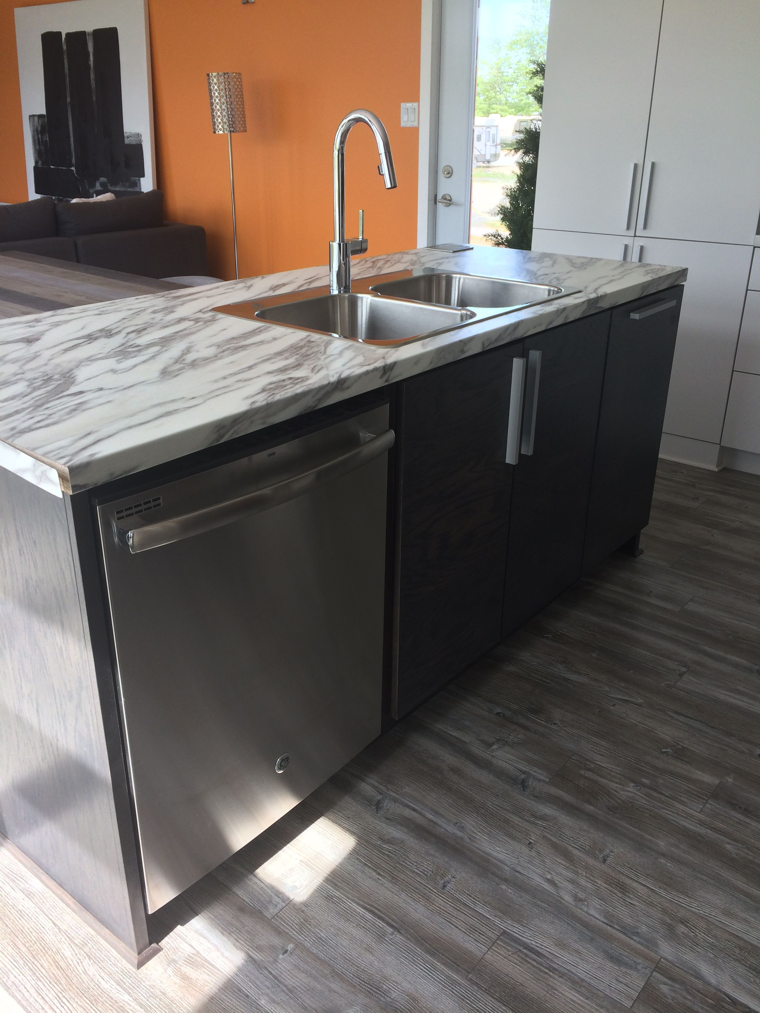 This Efficient L-shaped Kitchen Includes An Island With A