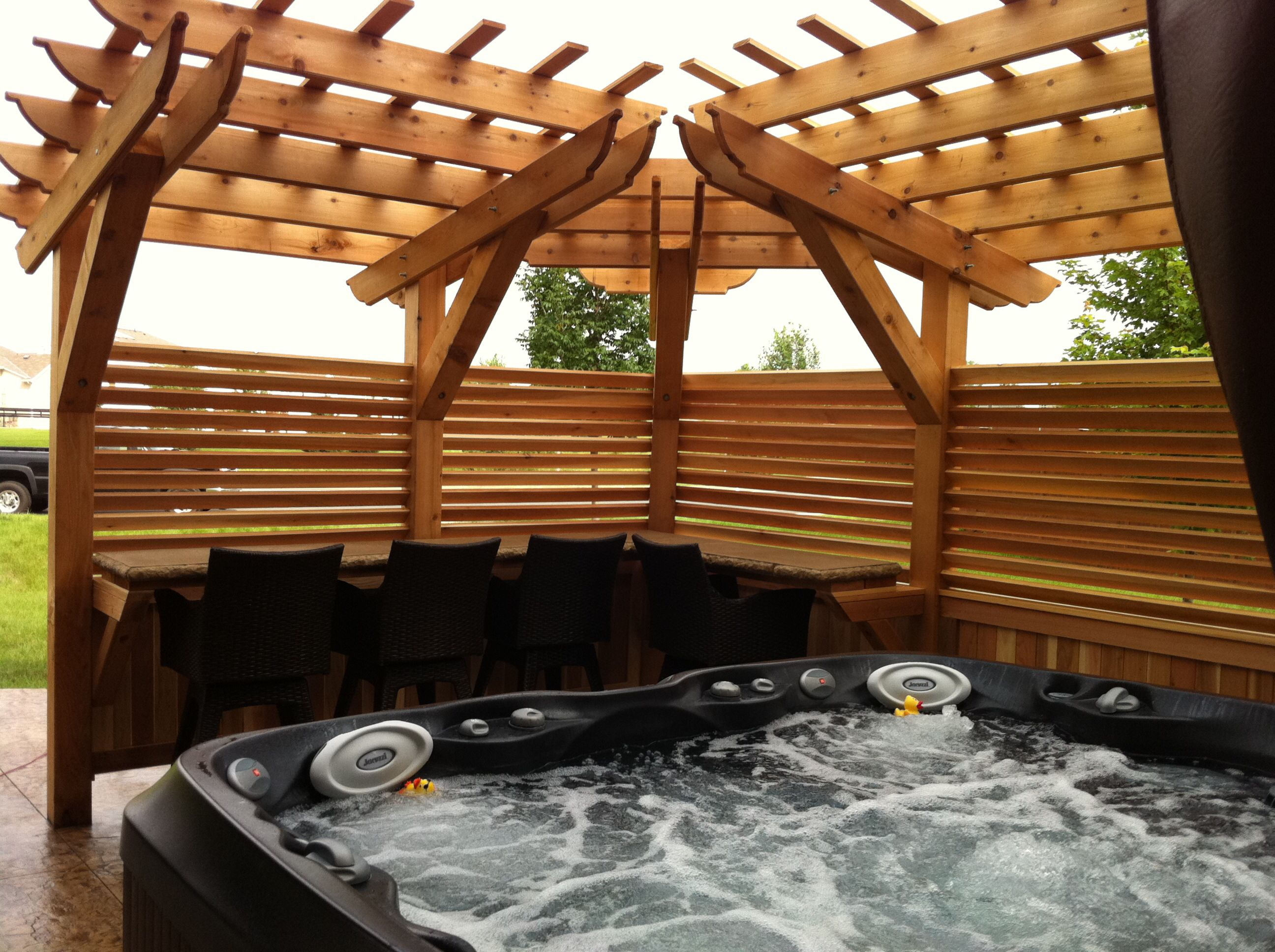 Stamped Concrete Hot Tub Patio With Custom Pergola For Privacy And Concrete  Bar Countertop