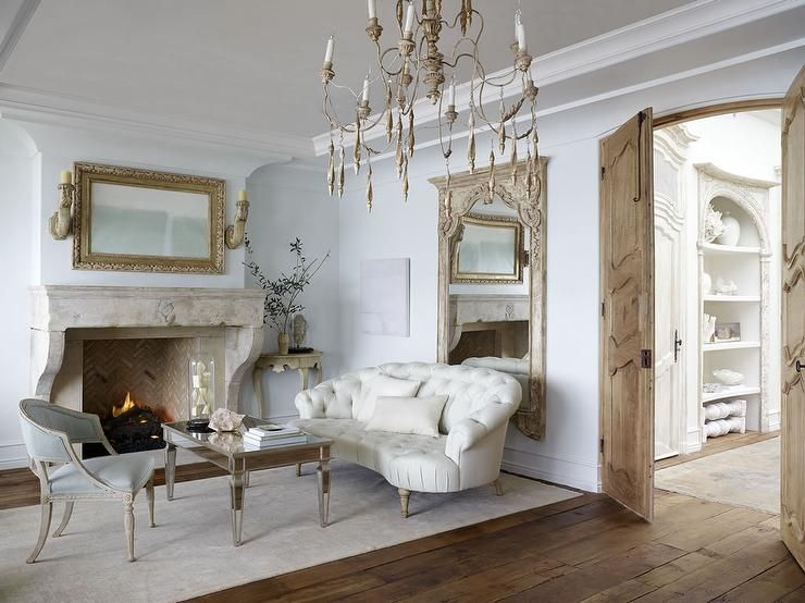 french provincial living rooms contemporary chairs for room uk with pale blue features a candle chandelier over mirrored